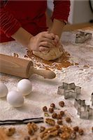 A child kneading biscuit dough on a floured work surface Stock Photo - Premium Royalty-Freenull, Code: 659-06188552