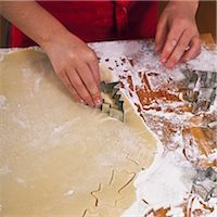 Christmas biscuits being cut out Stock Photo - Premium Royalty-Freenull, Code: 659-06188554