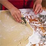 Christmas biscuits being cut out Stock Photo - Premium Royalty-Free, Artist: Blend Images, Code: 659-06188554