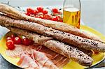 Bread sticks, raw ham and cherry tomatoes Stock Photo - Premium Royalty-Free, Artist: Cultura RM, Code: 659-06188566