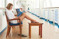 Teenage Girl Reading Book on Cruise Ship Stock Photo - Premium Rights-Managednull, Code: 700-06190526