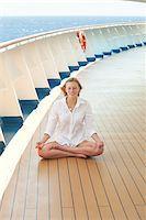 Teenage Girl Meditating on Cruise Ship Deck Stock Photo - Premium Rights-Managednull, Code: 700-06190529