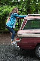 female rear end - Teenage Girls Hanging on to Back of Car Stock Photo - Premium Rights-Managednull, Code: 700-06190615