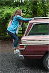 Teenage Girls Hanging on to Back of Car Stock Photo - Premium Rights-Managed, Artist: Ty Milford, Code: 700-06190615