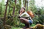 Young Woman Crouching in Forest Stock Photo - Premium Rights-Managed, Artist: Ty Milford, Code: 700-06190631