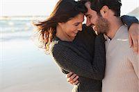 Smiling couple hugging on beach Stock Photo - Premium Royalty-Freenull, Code: 635-06191659