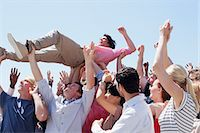 Man crowd surfing Stock Photo - Premium Royalty-Freenull, Code: 635-06191669