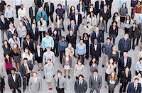 Portrait of business people in crowd Stock Photo - Premium Royalty-Freenull, Code: 635-06191674