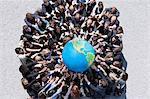 Crowd of business people in huddle reaching for globe Stock Photo - Premium Royalty-Free, Artist: Jose Luis Stephens, Code: 635-06191676