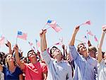 Smiling people waving American flags and looking up in crowd Stock Photo - Premium Royalty-Freenull, Code: 635-06191691