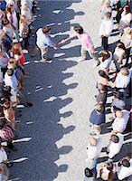 Men handshaking between separate groups Stock Photo - Premium Royalty-Freenull, Code: 635-06191705
