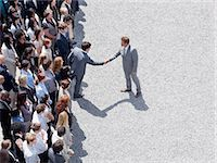 Businessman shaking man's hand in crowd Stock Photo - Premium Royalty-Freenull, Code: 635-06191706