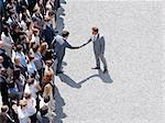 Businessman shaking man's hand in crowd Stock Photo - Premium Royalty-Free, Artist: Westend61, Code: 635-06191706