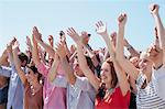 Cheering crowd with arms raised Stock Photo - Premium Royalty-Free, Artist: Blend Images, Code: 635-06191710