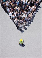 expectation - Construction worker at apex of pyramid formed by business people Stock Photo - Premium Royalty-Freenull, Code: 635-06191718