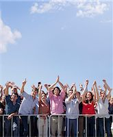 Cheering crowd with arms raised Stock Photo - Premium Royalty-Freenull, Code: 635-06191724
