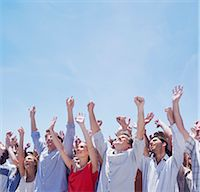 Cheering crowd with arms raised Stock Photo - Premium Royalty-Freenull, Code: 635-06191731