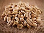 Close up of raw coffee beans Stock Photo - Premium Royalty-Free, Artist: Beanstock Images, Code: 635-06191748
