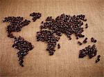 Coffee beans forming world map on burlap Stock Photo - Premium Royalty-Freenull, Code: 635-06191752
