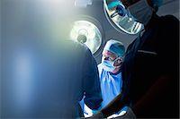 Surgeons working in operating room Stock Photo - Premium Royalty-Freenull, Code: 635-06191913