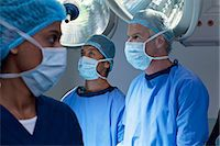 Surgeons working in operating room Stock Photo - Premium Royalty-Freenull, Code: 635-06191978