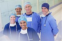 Portrait of smiling surgeons and nurses in hospital corridor Stock Photo - Premium Royalty-Freenull, Code: 635-06191990