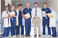 Portrait of confident doctors and nurses in hospital corridor Stock Photo - Premium Royalty-Freenull, Code: 635-06191994