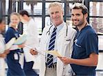 Portrait of smiling doctor and nurse in hospital Stock Photo - Premium Royalty-Free, Artist: Blend Images, Code: 635-06191998