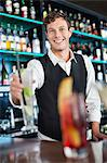 Portrait of smiling bartender holding cocktail Stock Photo - Premium Royalty-Free, Artist: R. Ian Lloyd, Code: 635-06192009