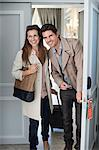Smiling couple opening hotel room door Stock Photo - Premium Royalty-Freenull, Code: 635-06192012
