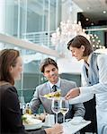 Waitress serving food to couple in restaurant Stock Photo - Premium Royalty-Freenull, Code: 635-06192039
