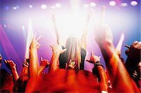 Stage lights shining on audience with arms raised at music concert Stock Photo - Premium Royalty-Freenull, Code: 635-06192045