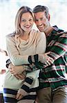 Portrait of smiling couple hugging Stock Photo - Premium Royalty-Freenull, Code: 635-06192074
