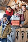 Portrait of smiling couples with Christmas gifts on cabin porch Stock Photo - Premium Royalty-Free, Artist: I Dream Stock, Code: 635-06192081