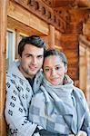 Portrait of smiling couple hugging on cabin porch Stock Photo - Premium Royalty-Freenull, Code: 635-06192114