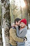 Portrait of smiling couple hugging in snowy woods Stock Photo - Premium Royalty-Free, Artist: I Dream Stock, Code: 635-06192144