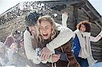 Friends enjoying snowball fight Stock Photo - Premium Royalty-Free, Artist: ableimages, Code: 635-06192147