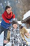 Woman breaking snowball over man's head Stock Photo - Premium Royalty-Free, Artist: TSUYOI, Code: 635-06192151