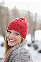 Close up portrait of smiling woman with red knit hat Stock Photo - Premium Royalty-Freenull, Code: 635-06192158