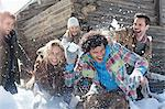 Friends enjoying snowball fight Stock Photo - Premium Royalty-Free, Artist: ableimages, Code: 635-06192165