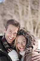 Portrait of smiling couple hugging outdoors Stock Photo - Premium Royalty-Freenull, Code: 635-06192168