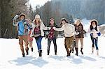 Smiling friends throwing snowballs in field Stock Photo - Premium Royalty-Free, Artist: TSUYOI, Code: 635-06192169