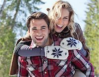 Portrait of smiling couple piggybacking Stock Photo - Premium Royalty-Freenull, Code: 635-06192180