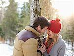 Couple hugging face to face in snowy woods Stock Photo - Premium Royalty-Free, Artist: I Dream Stock, Code: 635-06192192
