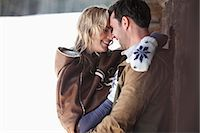 Smiling couple hugging in snow Stock Photo - Premium Royalty-Freenull, Code: 635-06192205