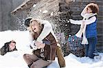 Laughing friends enjoying snowball fight Stock Photo - Premium Royalty-Free, Artist: ableimages, Code: 635-06192216