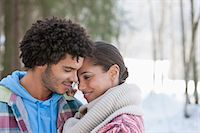 Smiling couple hugging face to face in snowy woods Stock Photo - Premium Royalty-Freenull, Code: 635-06192217