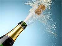 exploding - Champagne and cork exploding from bottle Stock Photo - Premium Royalty-Freenull, Code: 635-06192307