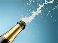 Champagne exploding from bottle Stock Photo - Premium Royalty-Freenull, Code: 635-06192308