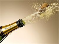 exploding - Champagne and cork exploding from bottle Stock Photo - Premium Royalty-Freenull, Code: 635-06192310